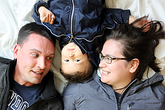 Smiling family with baby