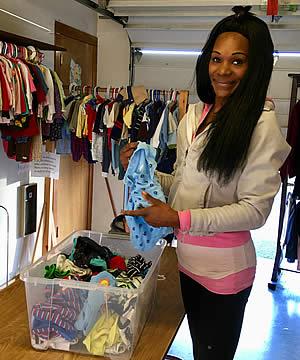 Volunteer organizing clothing